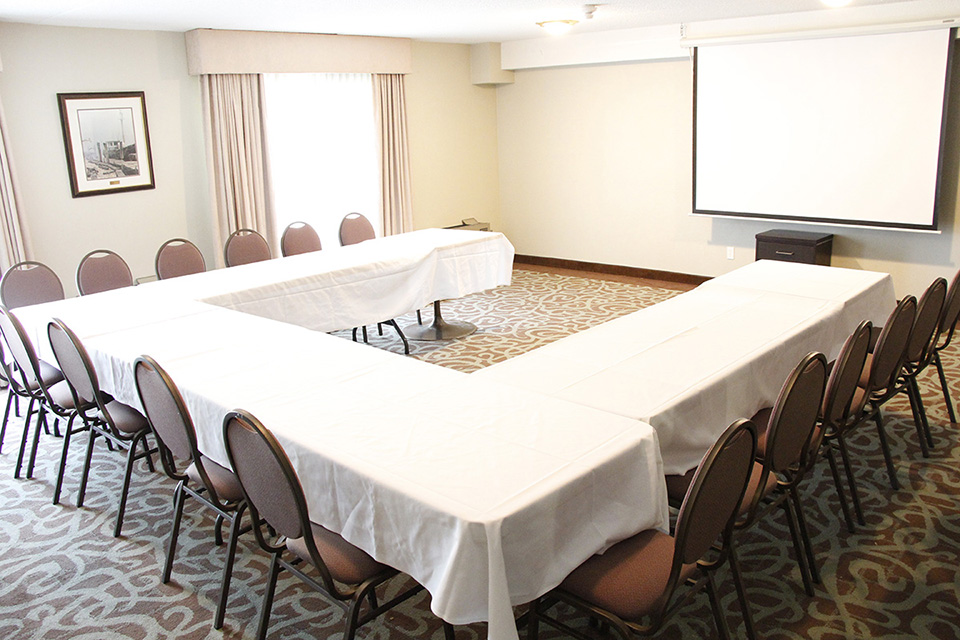 Conference room with U table and a presentation board